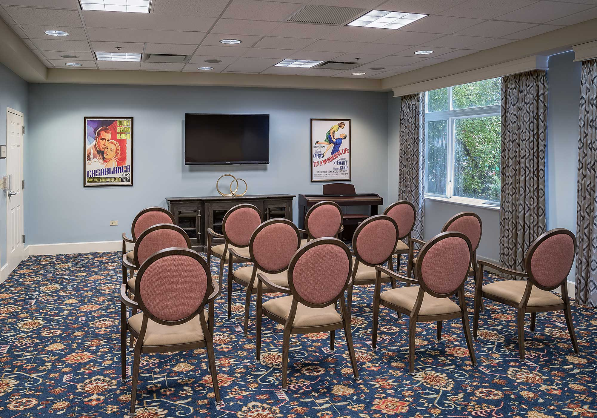 Meeting room filled with chairs with round backs