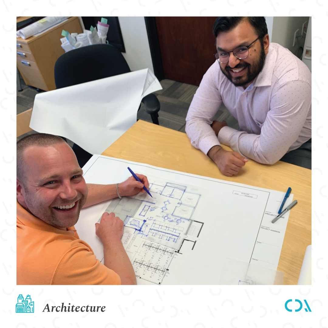 That's why you always make a plan. Steve and Ali, from our Los Angeles office, are reviewing detailed drawings. No matter where our client's projects are in the country, we have the local expertise to provide architectural excellence because we know that implementing an all-encompassing concept across your entire fleet is what makes a real impact.