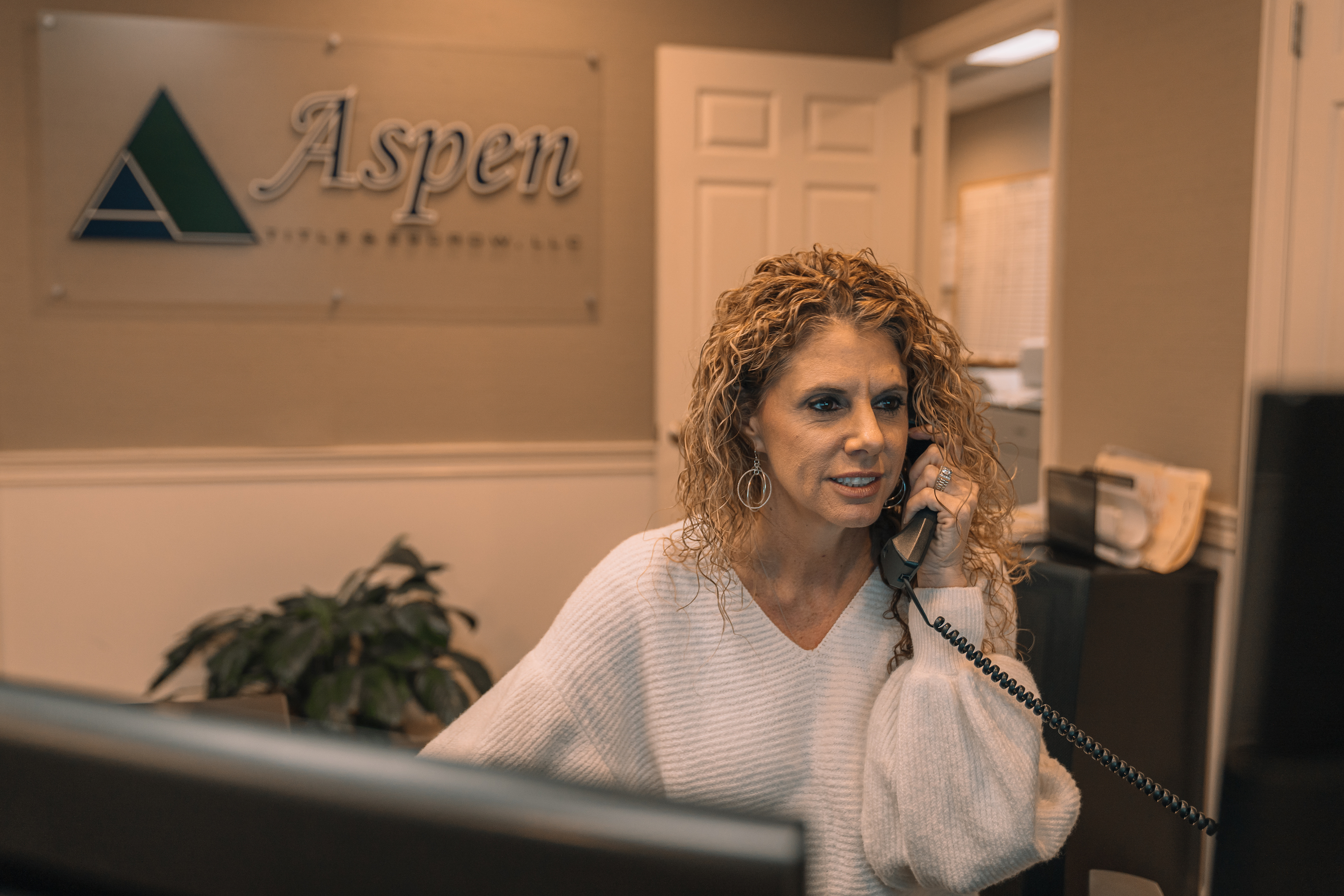 Aspen Title and Escrow employee working at her desk in their knoxville office located in east tennessee