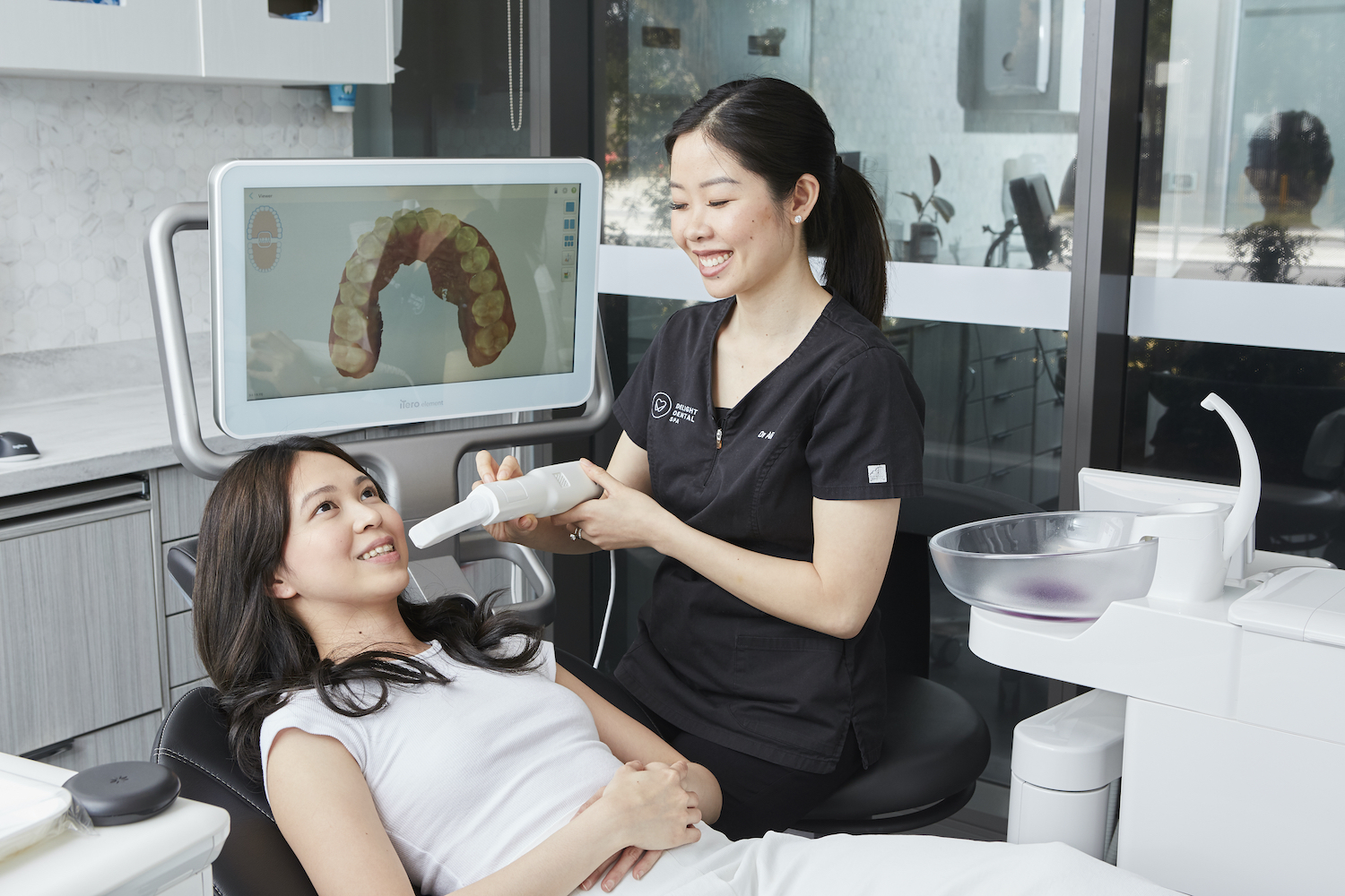 Patient being scanned with invisalign intraoral scanner
