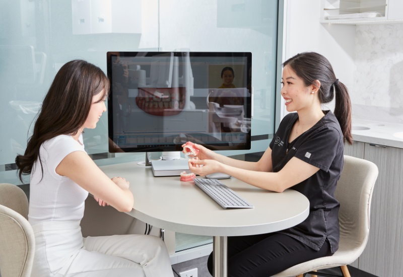 A patient discusses her Invisalign treatment plan with Dr Alice