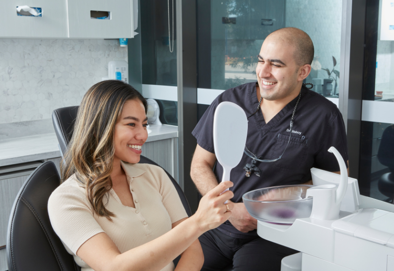 A Delight Dental Spa patient shows off her new smile after Invisalign treatment
