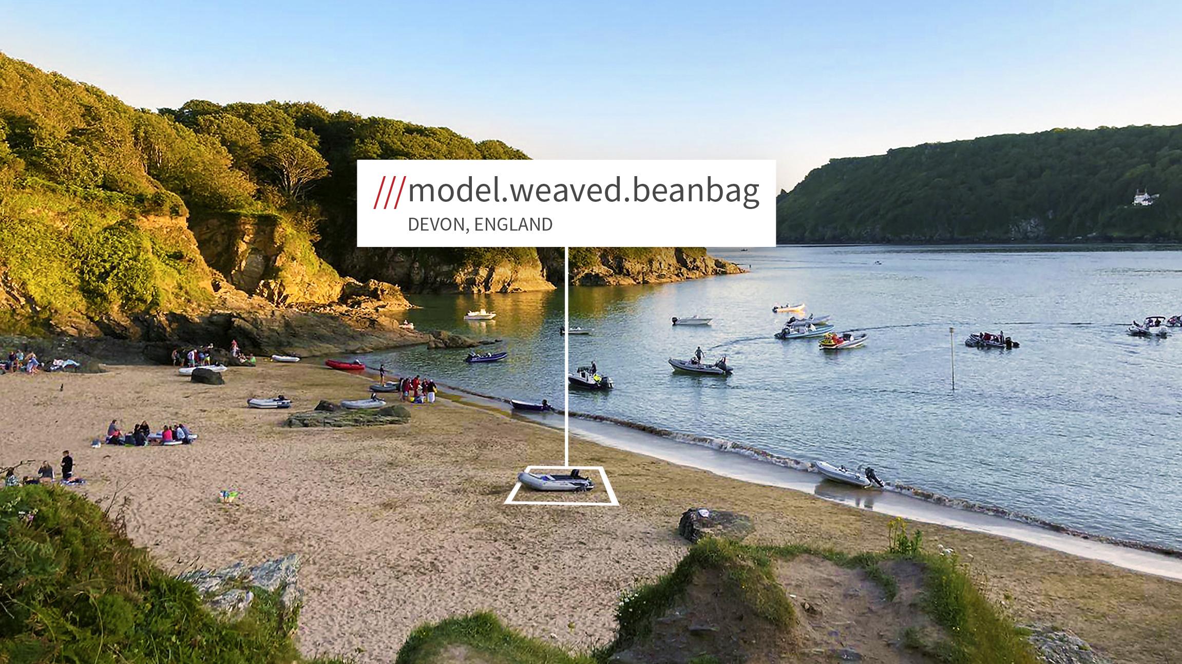 Scene of a bay in Devon with 3 words describing it (model, weaved, beanbag)