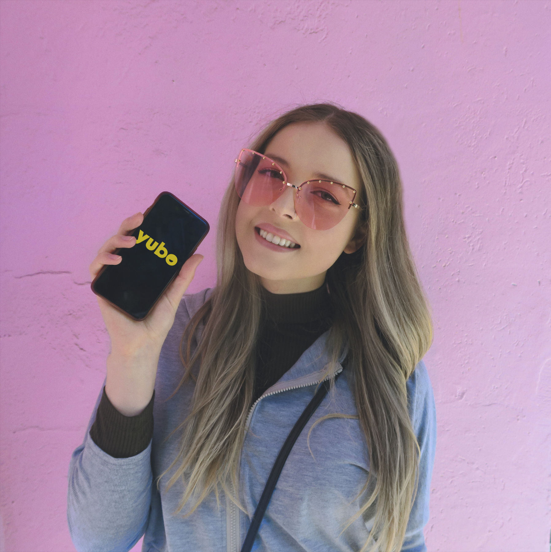 Influencer Maya holding her phone with the Yubo app open
