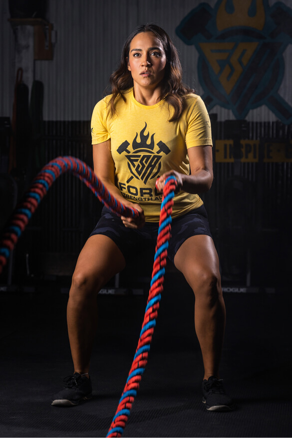 Woman fit training crossfit rope
