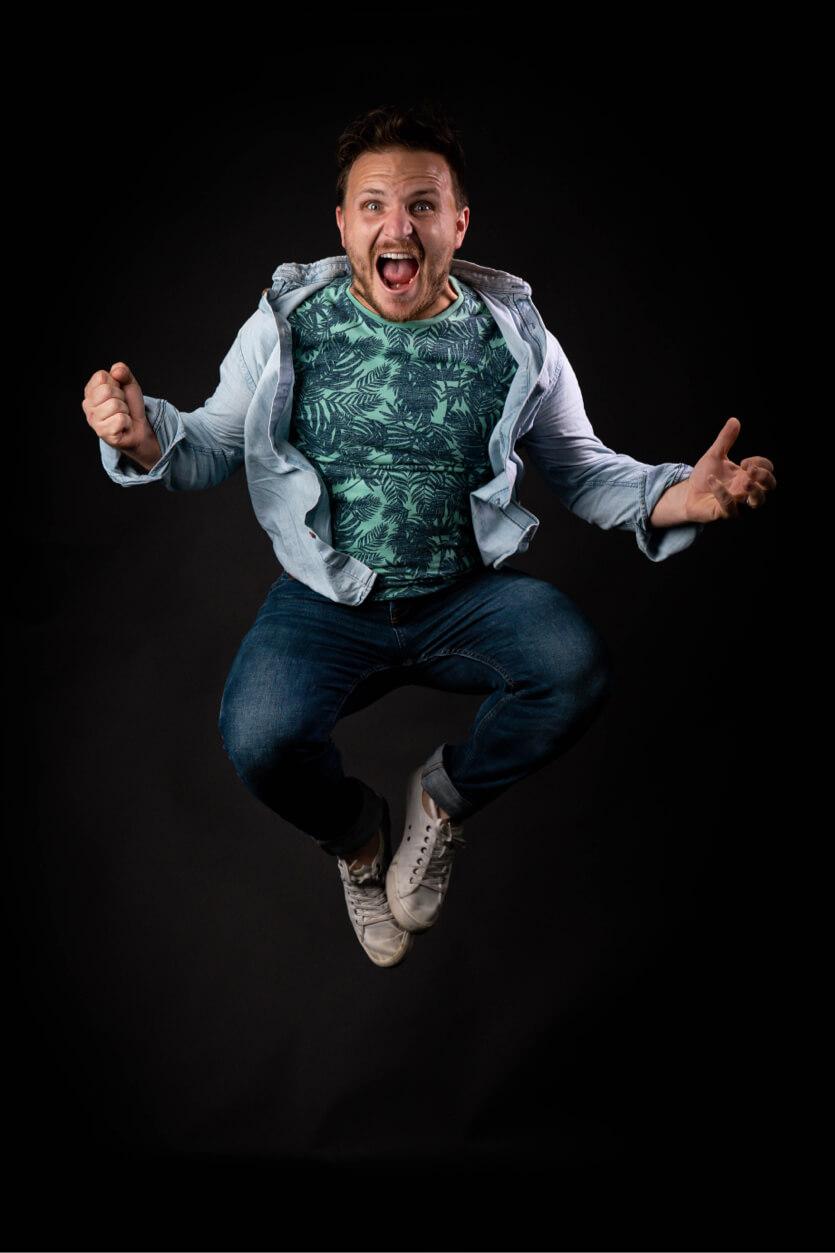Man jumping in photo studio