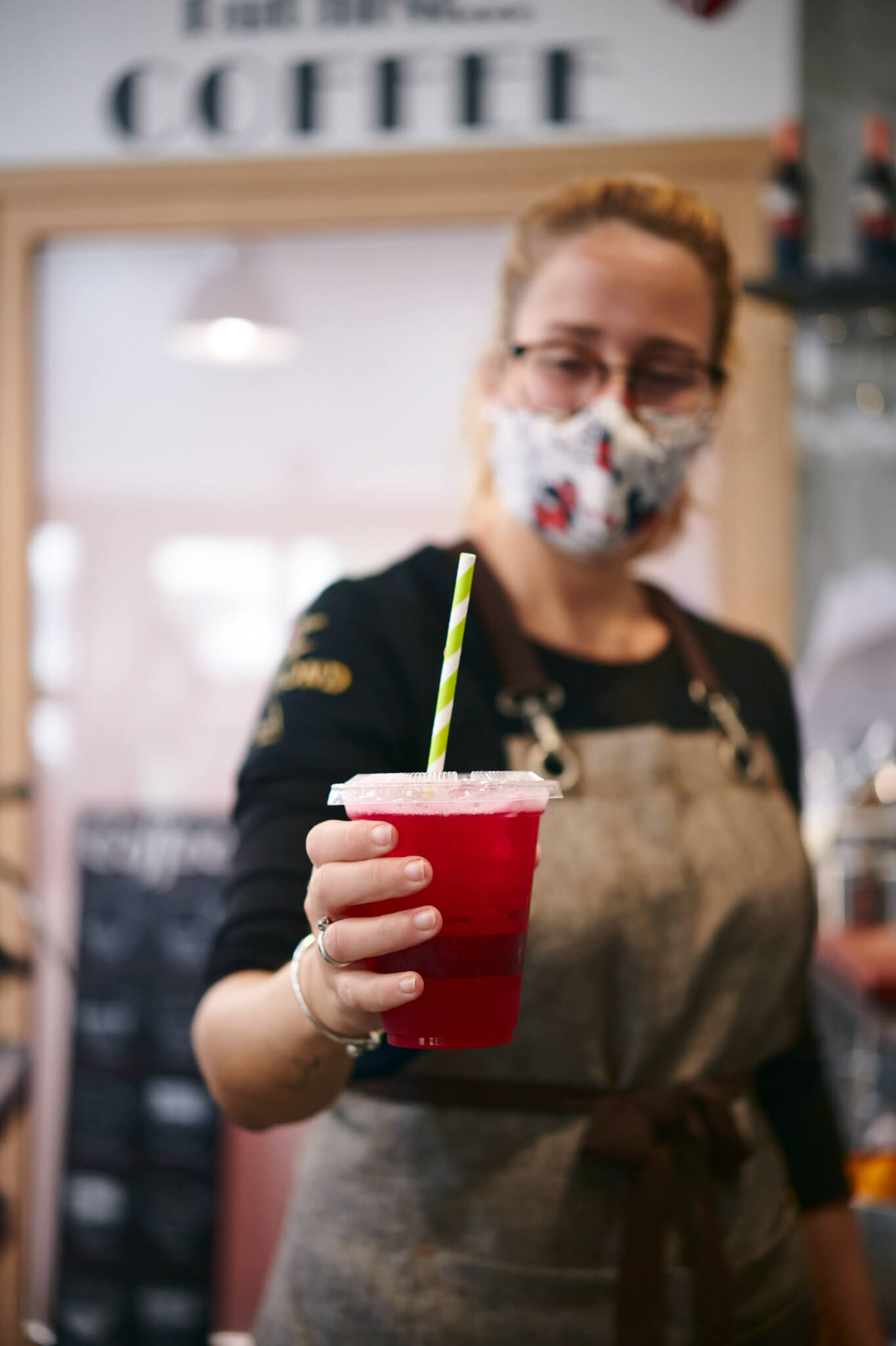 Staff holding a cherry lemonade