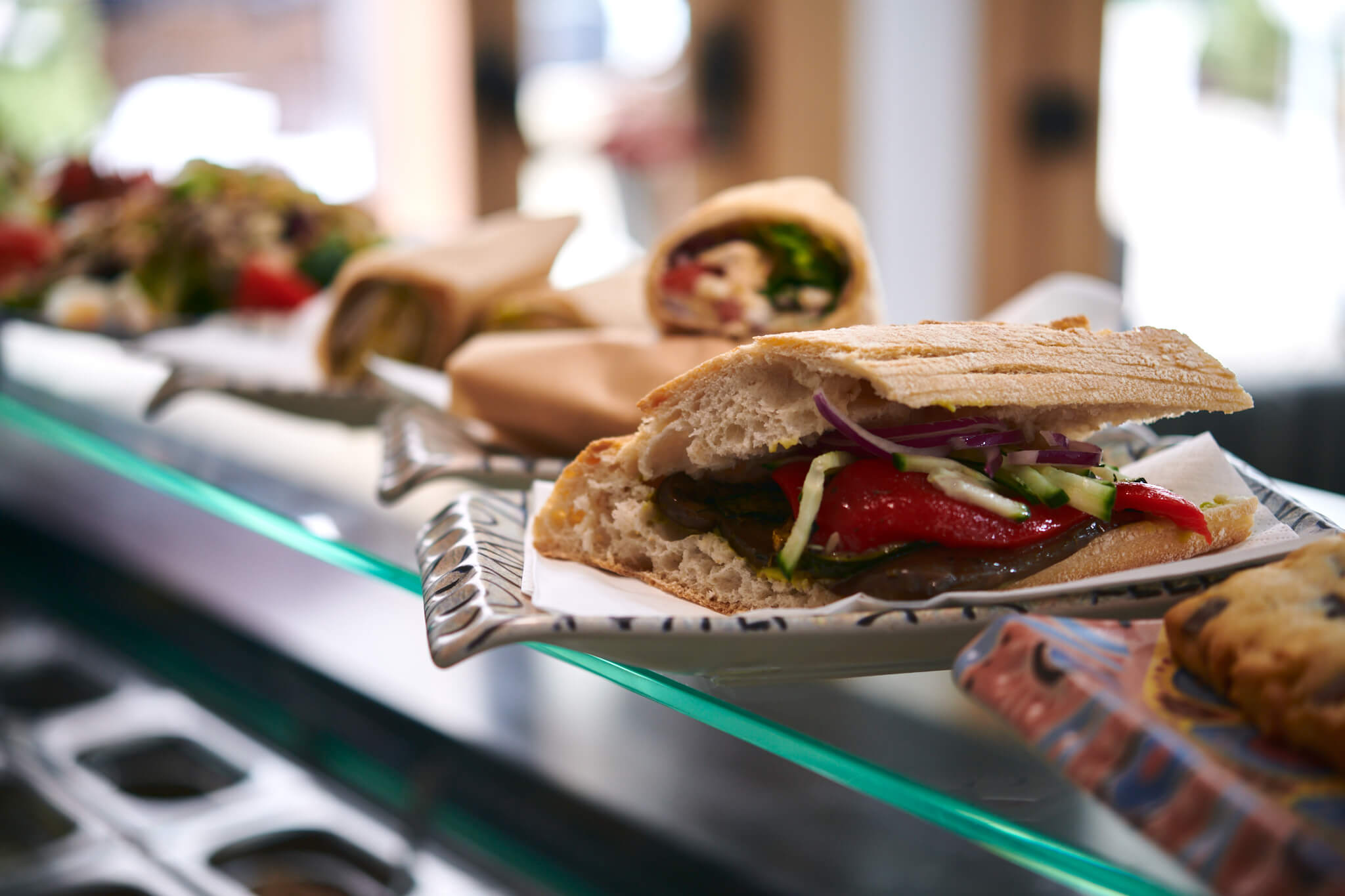 Multiple dishes including; wraps, sandwiches etc all ready to be served