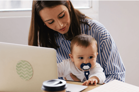 mom with a baby on computer