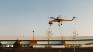 The S64 Erickson Air-Crane was used to lift rooftop equipment onto the Sears Warehouse roof in Belleville during original construction in 1990.