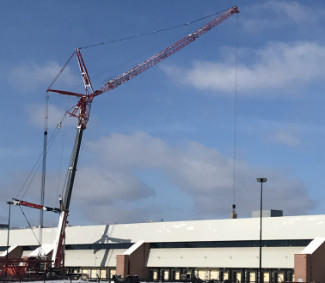 A 900 ton mobile crane hoists heavy rooftop equipment onto the Sears Warehouse in Belleville.