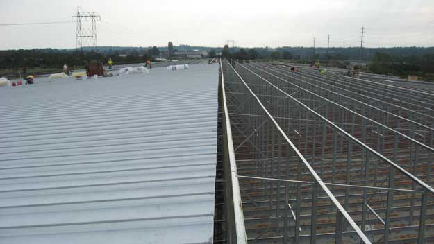 roof structure in process of being replaced with half of the outer roof material in place