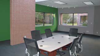 A spacious conference room is available for use at Bel-Con's new location.