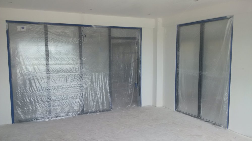 building windows covered in plastic during renovation