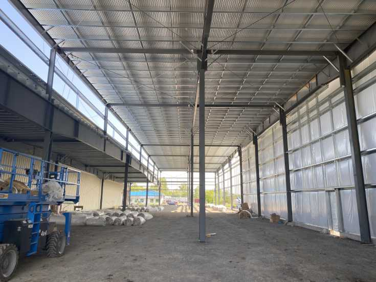 interior of manufacturing facility showing steel structure and roof