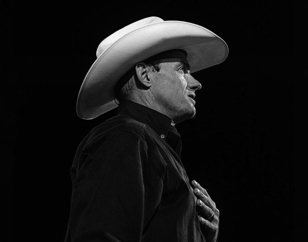 Todd Pierce in black and white on dark background