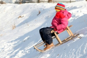 Girl sledding in the snow