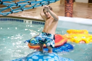 Kid playing in an indoor pool