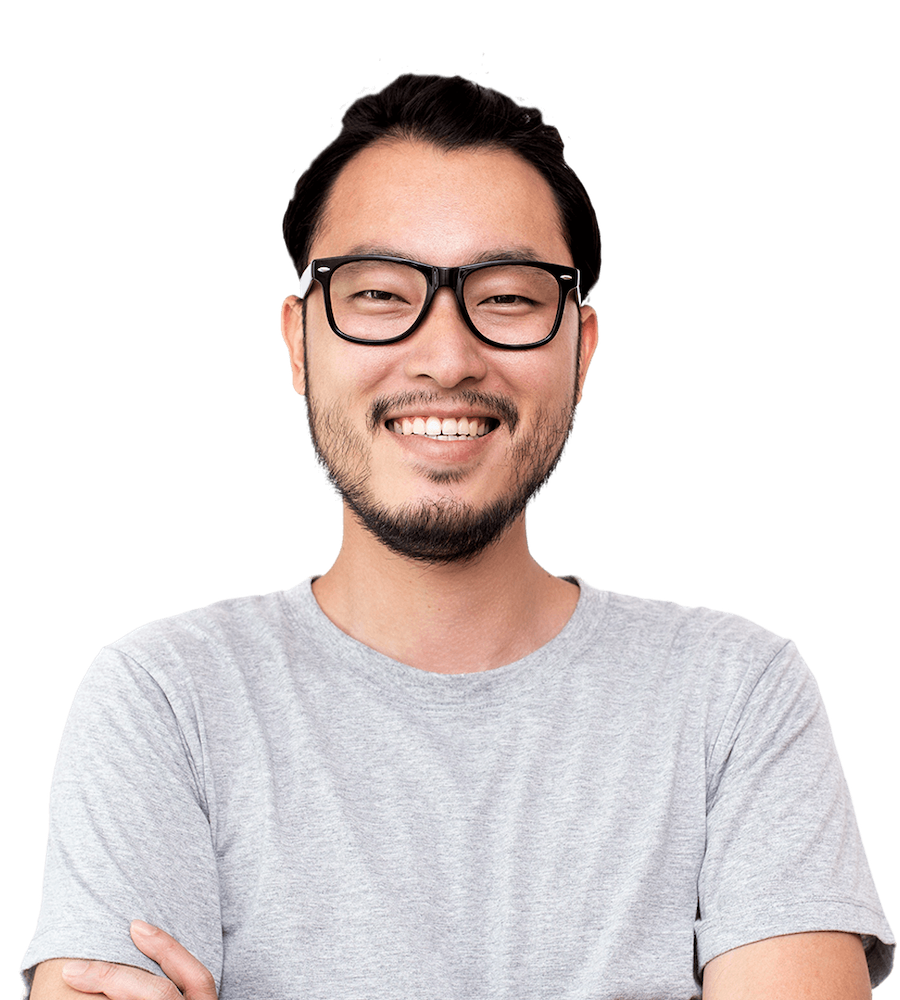 A man with a white tshirt and glasses looking at the camera getting ready for a virtual event
