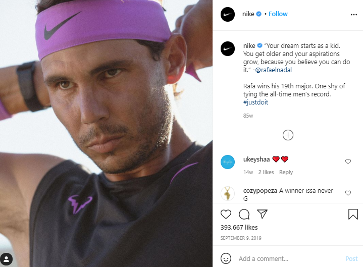 Nike's Instagram post featuring rafael nadal and their branded hashtag #JustDoIt
