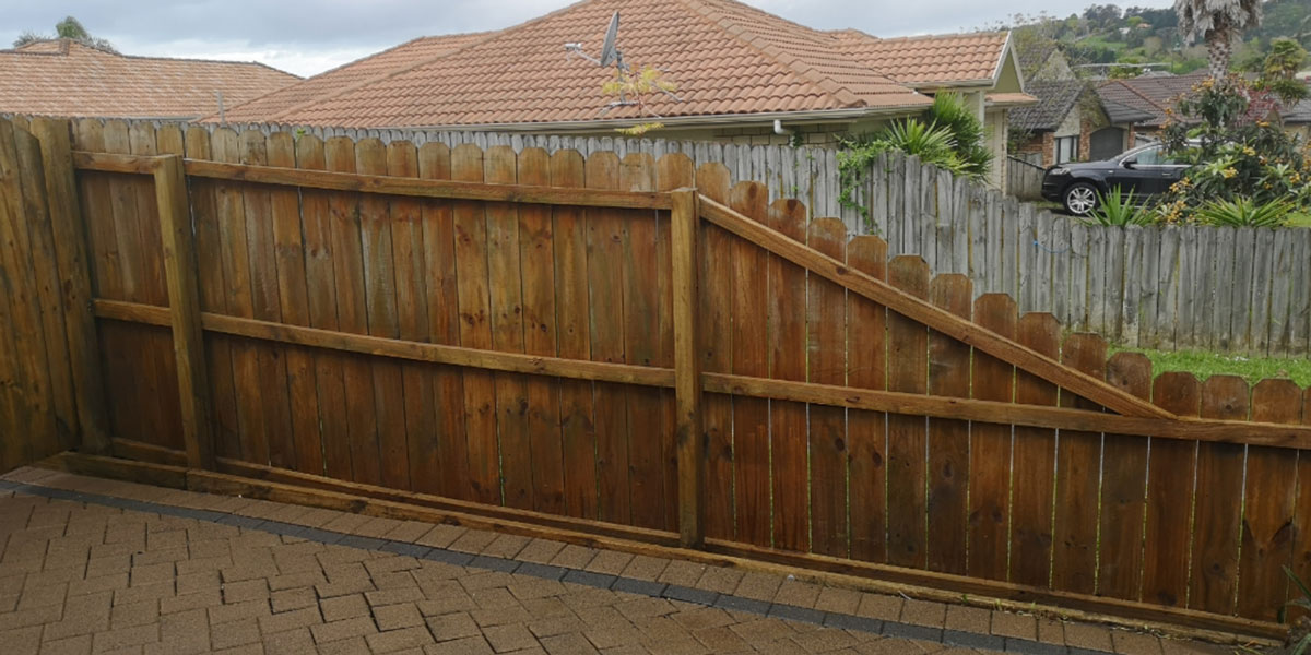A clean wood fence that looks new.
