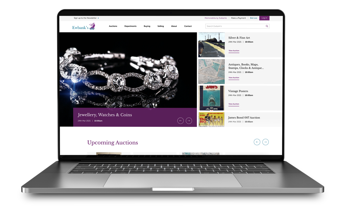 Ewbank's auction website displayed on macbook
