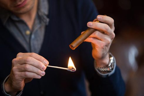 light-a-cigar-toasting-foot-with-match-1