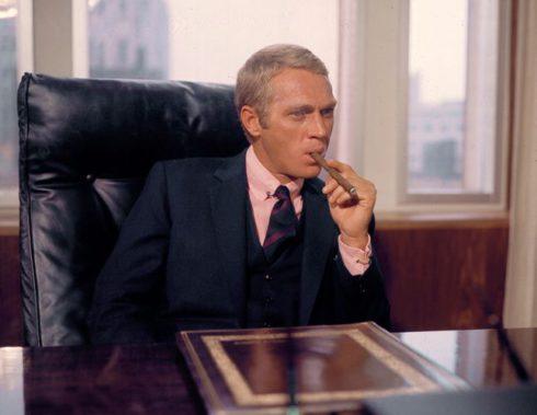 Steve McQueen smoking a cigar