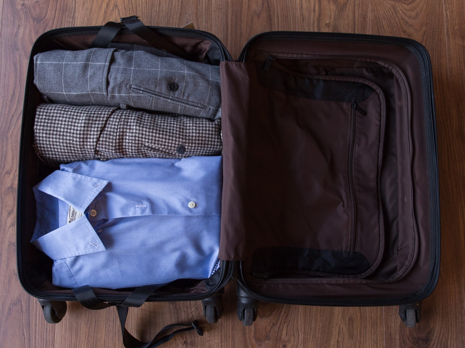 Jacket and trousers packed in a suitcase