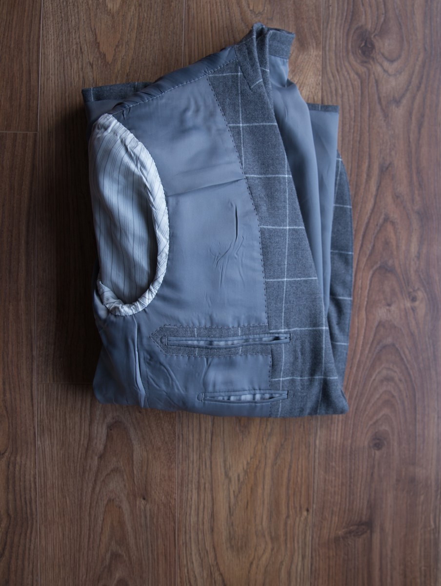 Folding a coat in a suitcase 4
