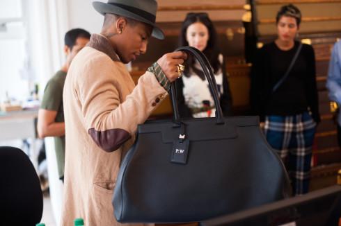 Pharrell Williams carrying Pauline Large_2