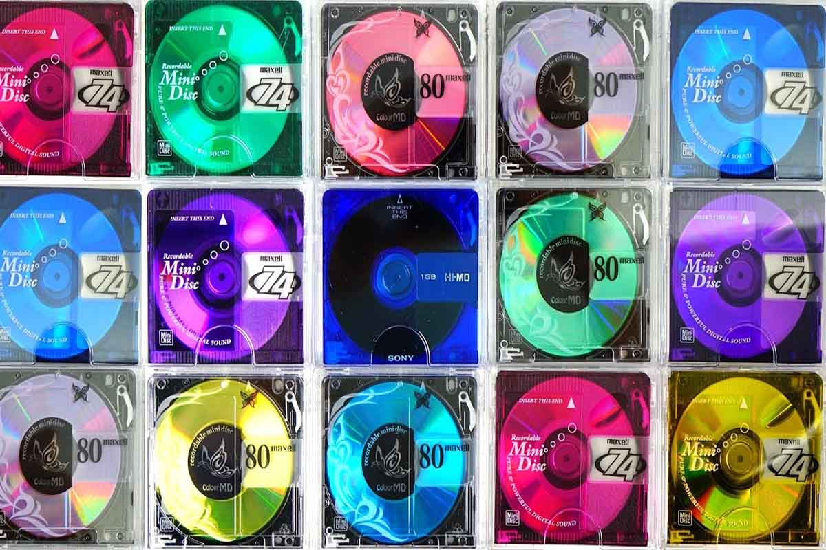 3 rows of differently coloured minidiscs. The image showcases a technology that was disrupted by Mp3