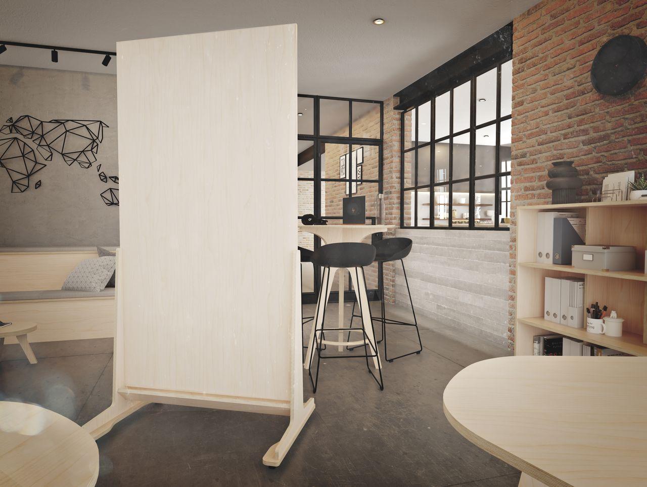 Séparateur en bois disposé entre un espace déjeuner et un espace détente au style et ambiance industriel