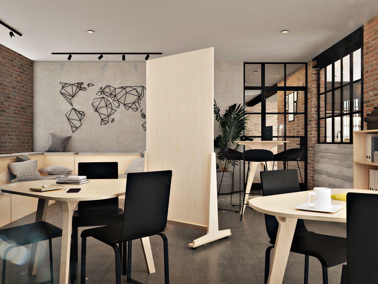 Panneau en bois disposé entre deux espaces aux fonctions différentes, l'un pour discuter avec ses collaborateurs pendant la pause café et l'autre pour réaliser des réunions rapides, dans une salle à la décoration  industrielle mêlant métal
