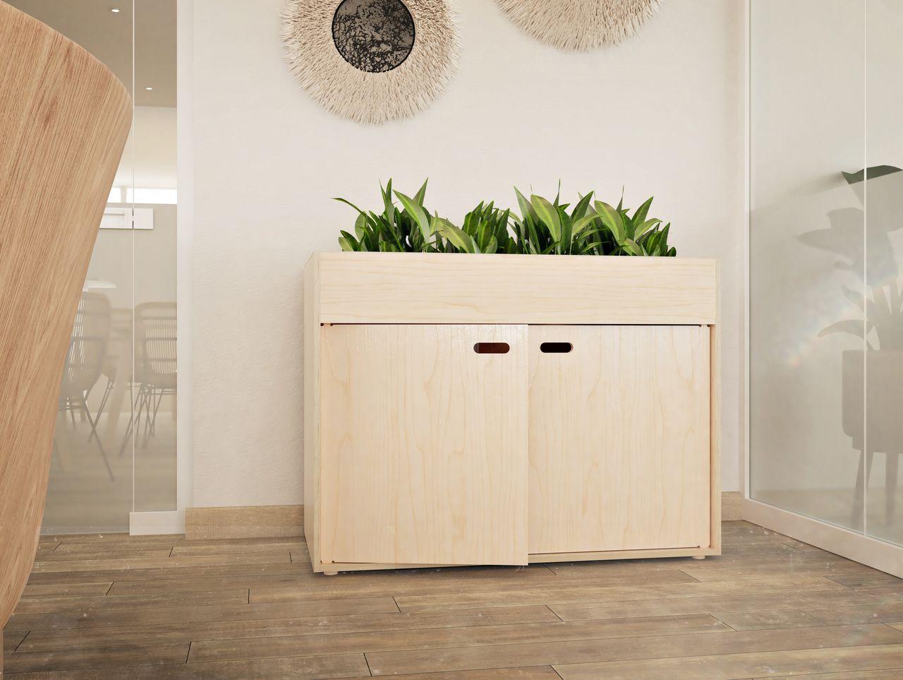 Meuble de rangement avec 2 portes personnalisées avec une gravure au nom de l'entreprise LOUIS et accessoirisé d'un bac à plante verte apportant un peu de couleur et de personnalité à cette salle de réunion au style bohème aux tons neutres