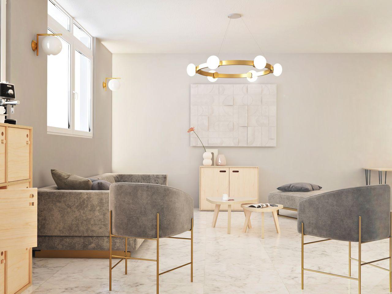 Meuble de rangement en bois disposé dans un espace détente à l'ambiance contemporaine avec son sol effet marbre et ses luminaires de couleur dorée