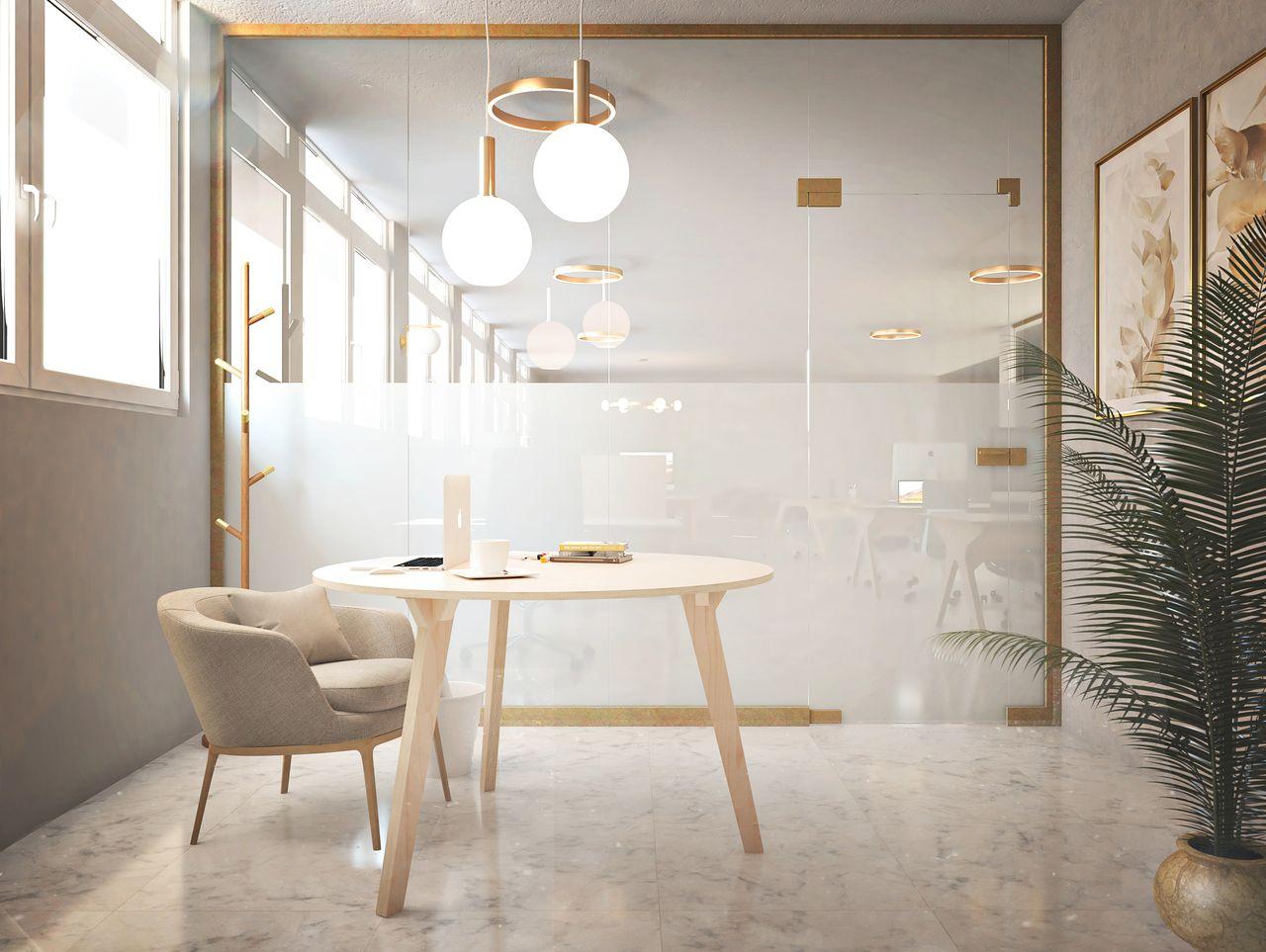table pour salle de réunion au style contemporain avec des tons blancs et dorés et une plante verte