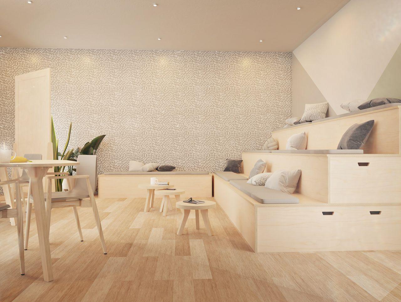 Auditorium formé de plusieurs estrades avec coussins. Modules de 1 à 3 niveaux dans un espace de travail collaboratif à l'ambiance scandinave.
