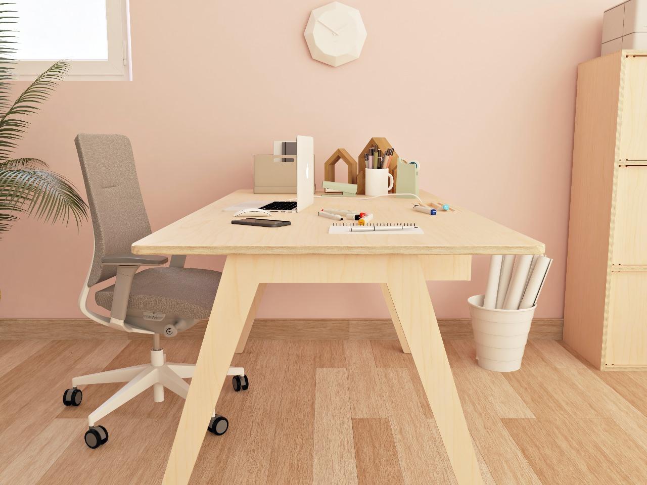 Bureau simple et moderne en bois avec une trappe faisant passer le câble de l'ordinateur, placé dans un espace de travail décoré avec des tons pastels