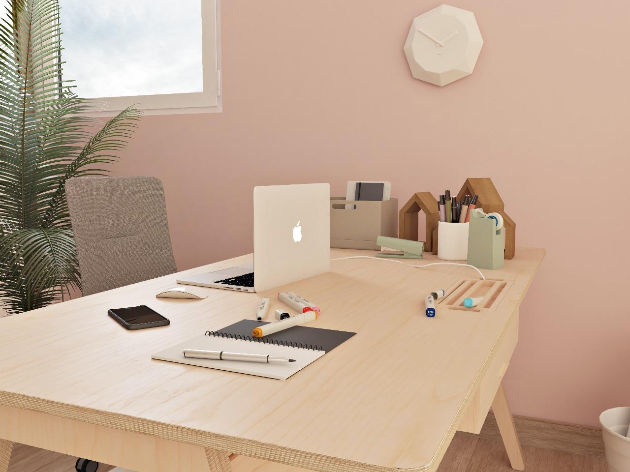 Bureau simple en bois au design de bureau treteau disposé dans un espace de créativité aux tons pastels et au style scandinave