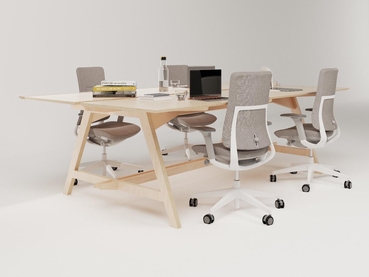 Table de réunion design en bois de bouleau pour 4 personnes avec des assises confortables de couleur grise idéale pour travailler sur l'ordinateur entre collaborateurs