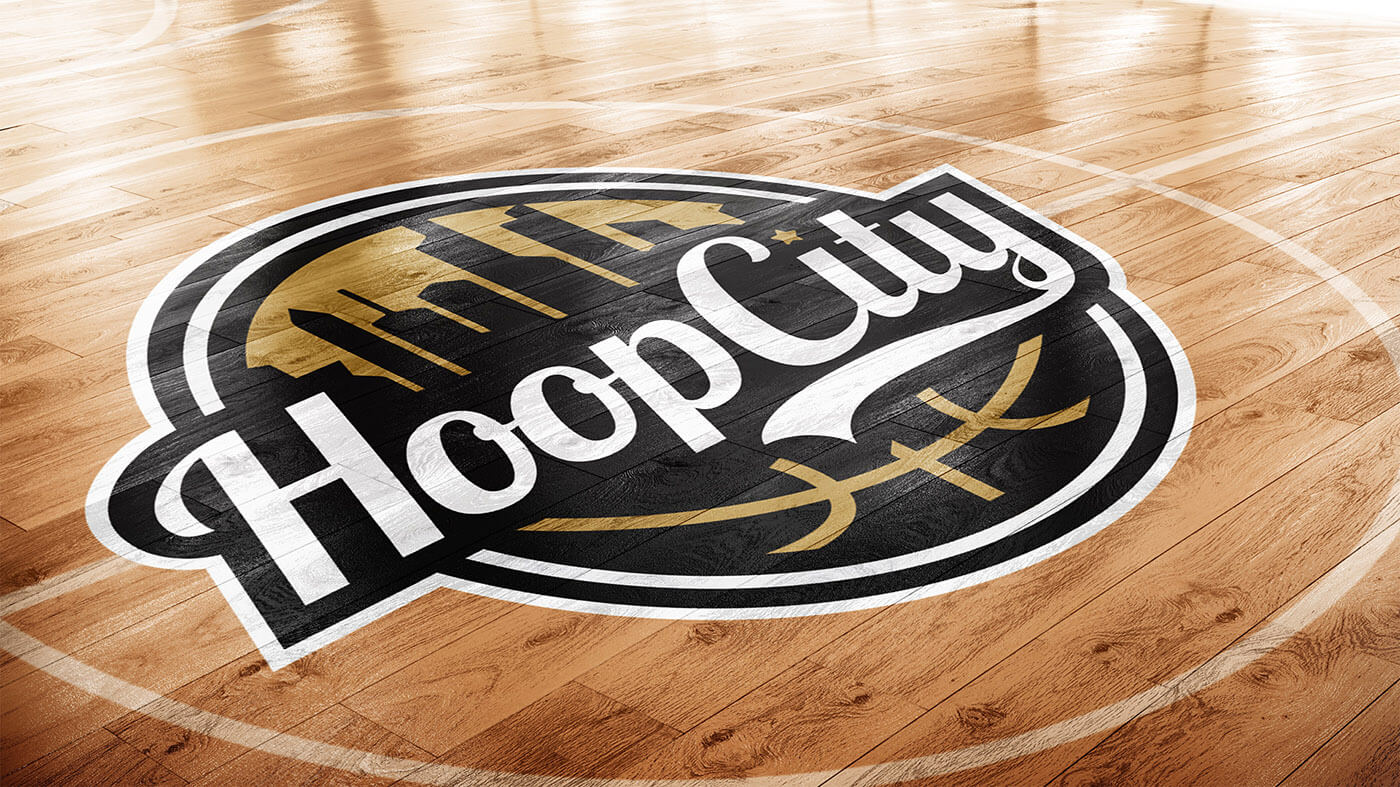 Hoop City Logo on a basketball court