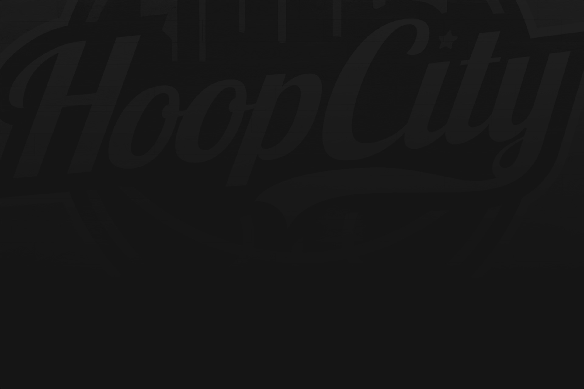 Basketball court with the Hoop City logo
