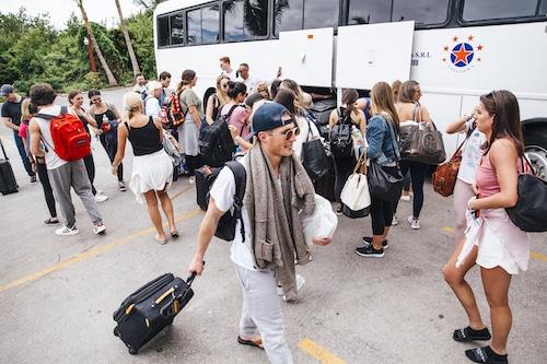 travelers using airport shuttles