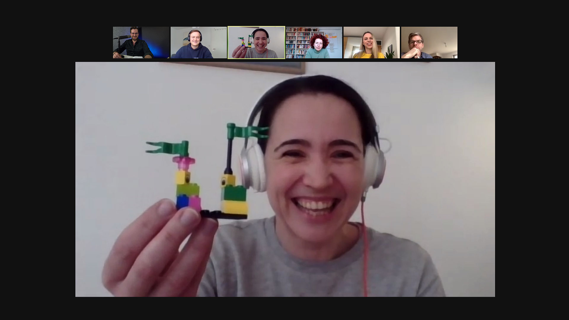 Woman showing Lego Model zoom meeting