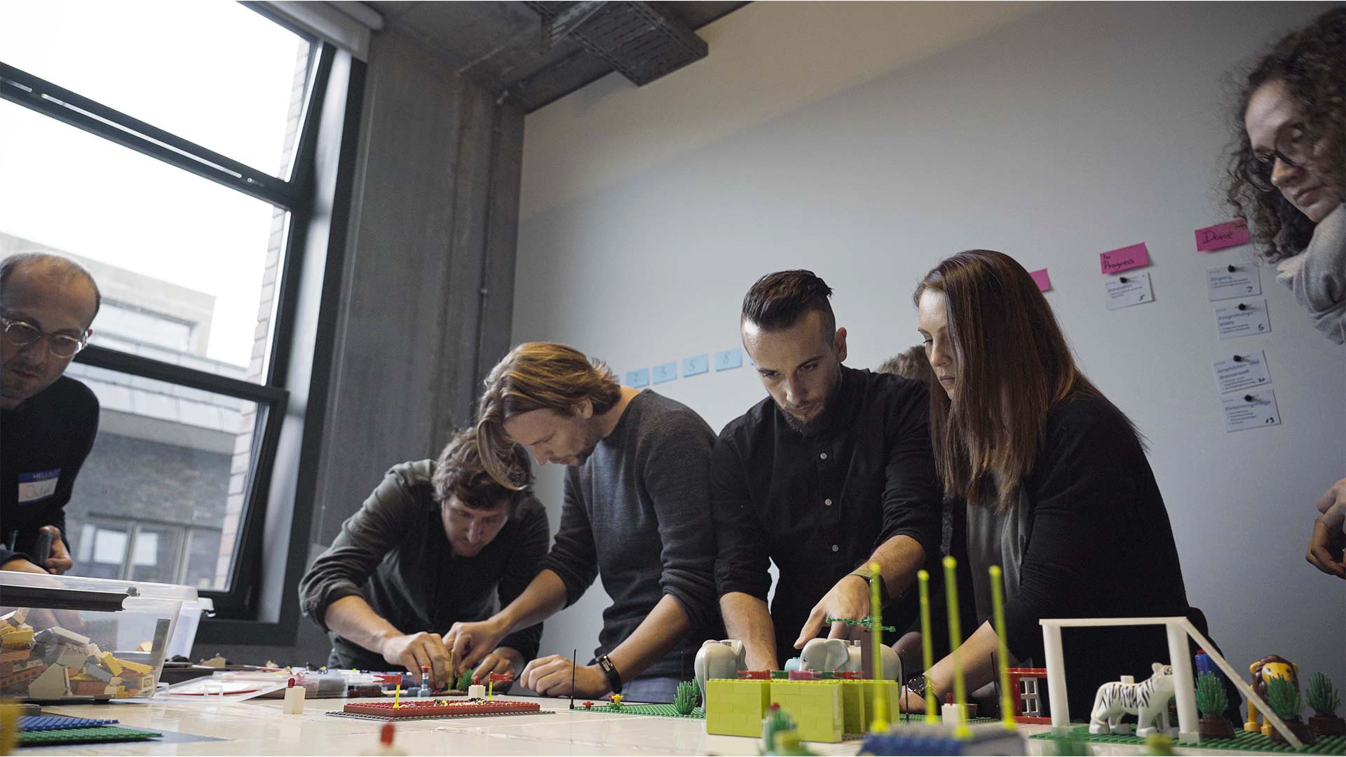 Group of People constructing with Lego