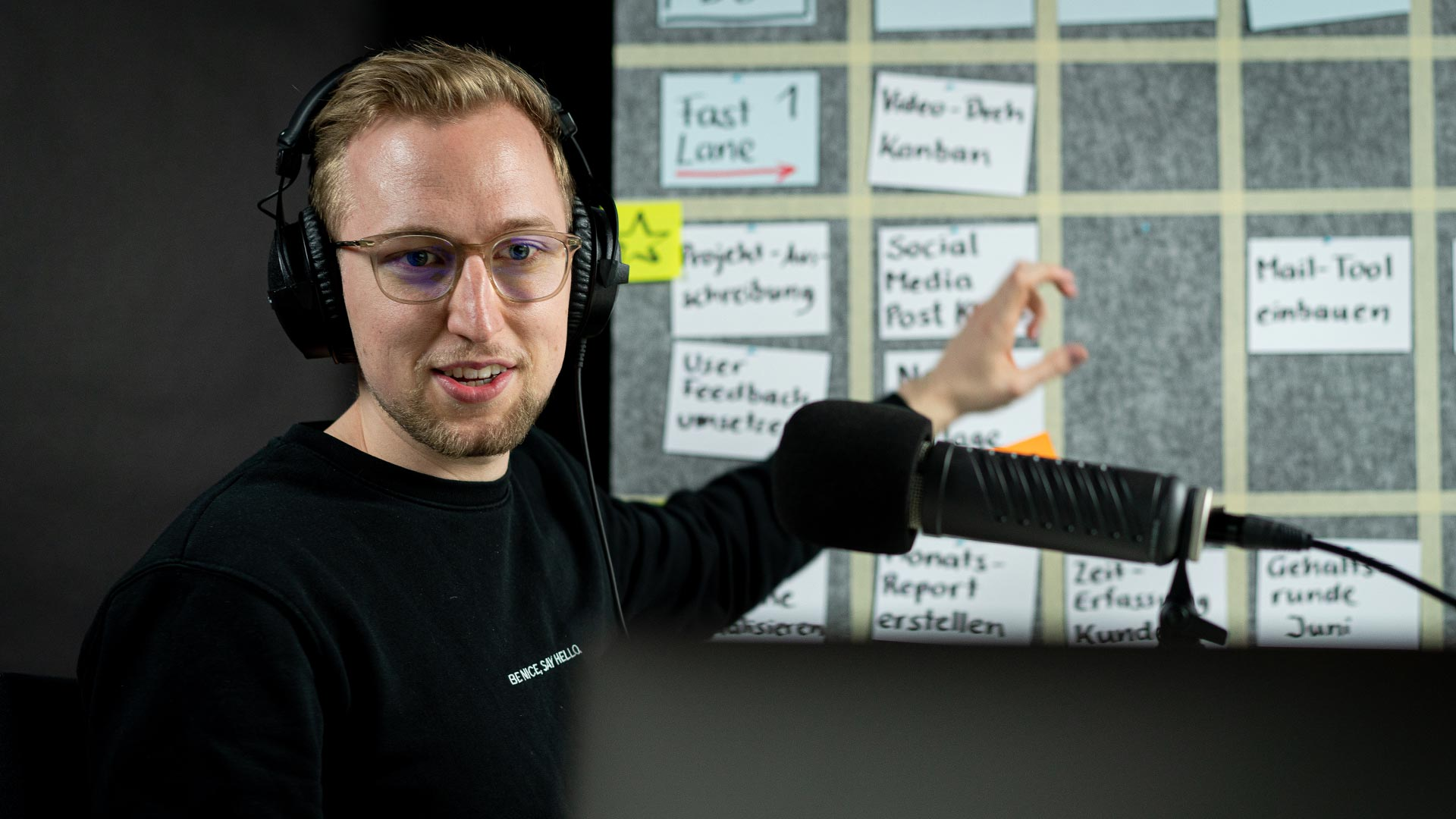 Man explaining scrum infront of microphone