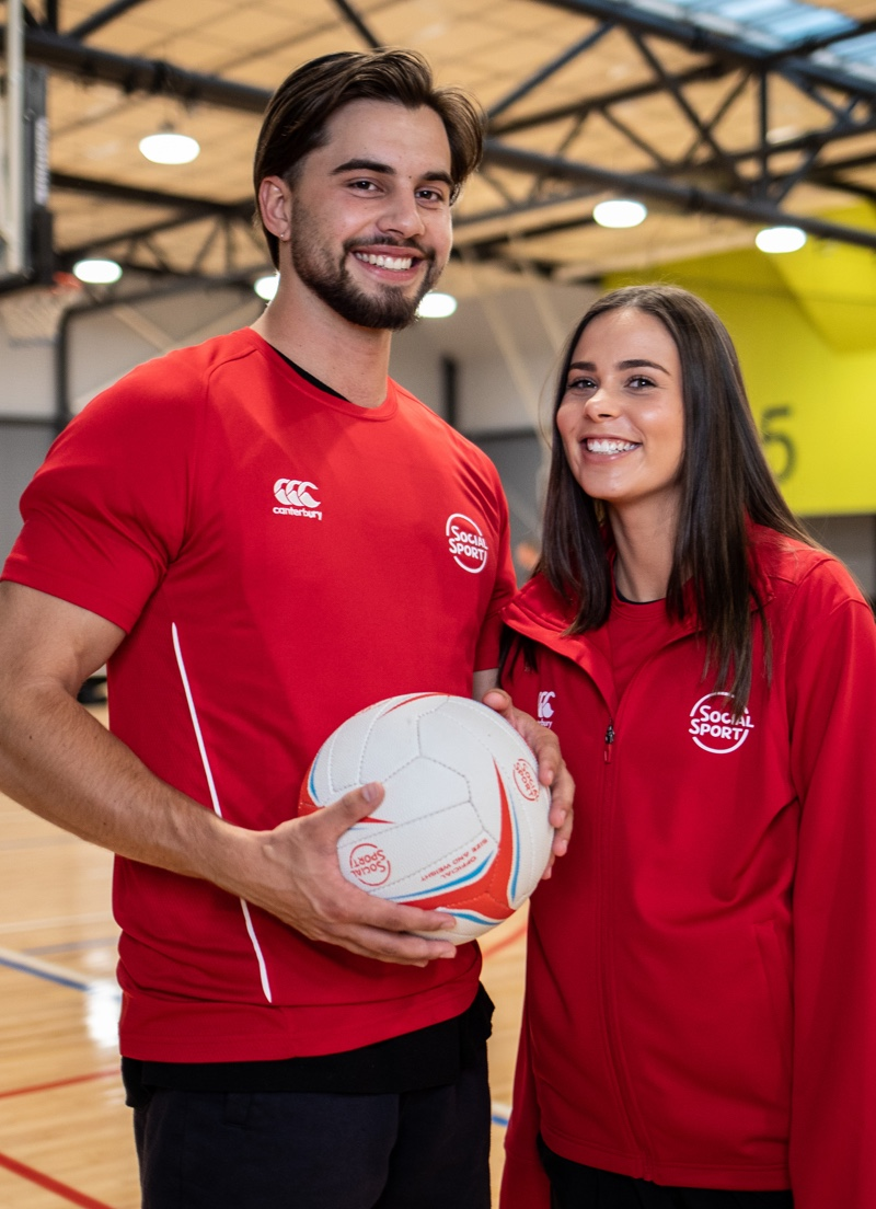 A male and female netball player