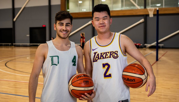 Two male social Basketball players stand next to each other