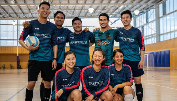 A mixed Futsal team stand for a team photo